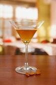 Tasty color liquor, on bright background — Stock Photo