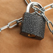 Stock Photo: Parcel with chain and padlock, close up