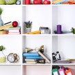 Beautiful white shelves with scattered different home related objects — Stock Photo #21043523