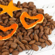Decorative hearts from dry orange peel with coffee beans on musical notes — Stock Photo