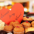 Sweet cookies with valentine card on table in cafe — Stock Photo #21044391
