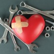 Heart and tools. Concept: Renovation of heart. On color background — Stock Photo #21046071
