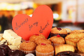 Sweet cookies with valentine card on table in cafe — Stok fotoğraf