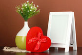 White photo frame for home decoration on brown background — Stock Photo