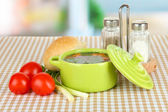 Fragrant soup in pan on table in kitchen — Stock Photo