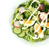 Fresh mixed salad with eggs, salad leaves and other vegetables, isolated on white — Stock Photo