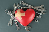 Heart and tools. Concept: Renovation of heart. On color background — Foto Stock