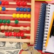 Bright wooden abacus and calculator. Conceptual photo of old and modern business — Stock Photo #21180681