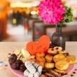 Sweet cookies with valentine card on plate on table in cafe — Stock Photo #21181387