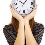 Mädchen halten Uhr übers Gesicht isoliert auf weiss — Stockfoto #21181571