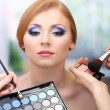 Portrait of beautiful young woman with making makeup in beauty salon — Foto de Stock