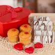 Sweet cookies with gift on table in cafe — Stock Photo #21181401