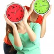 Girls holding clocks over face isolated on white — Stock Photo #21181585