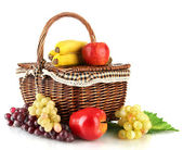 Picnic basket with fruits isolated on white — Stock Photo