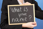 Young woman holding sign What is your name ? — Stock Photo