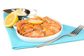Shrimps with lemon on plate isolated on white — Stock Photo