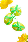 Bright easter eggs with bow and flowers, isolated on white — Stock Photo