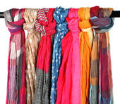 Many bright female scarfs isolated on white — Stockfoto