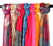 Many bright female scarfs isolated on white — Stock Photo