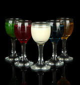 Tasty color liquors, isolated on black — Stock Photo