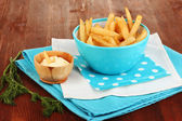 French fries in bowl on wooden table close-up — Stock Photo