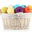 Colorful yarn balls in wicker basket isolated on white — Stock Photo