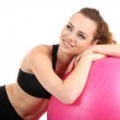 Young woman with gym ball isolated on white — Stock Photo