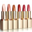 Photo: Beautiful lipsticks, isolated on white