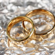 Wedding rings on silver background — Foto Stock