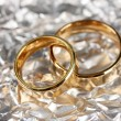 Wedding rings on silver background — Stock Photo #21234061