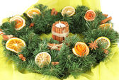 Christmas wreath with burning candle on fabric background — 图库照片