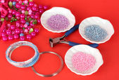 Set for needlework on red background — Stok fotoğraf