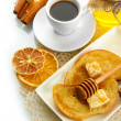 White bread toast with honey and cup of coffee, isolated on white - Stock Photo