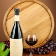 Composition of wine, wooden barrel and  grape, on brown background — Stockfoto