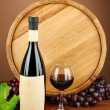Stock Photo: Composition of wine, wooden barrel and grape, on brown background