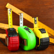 Stock Photo: Tape measure and ruler on wooden background
