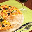 Tasty pizza with wine on wooden table close-up — Stock Photo
