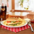 Stock Photo: Tasty cheeseburger with fried potatoes and cold drink, on bright background