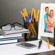 White photo frame on office desk on grey background — Stock Photo