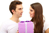 Loving couple with gift isolated on white — Stok fotoğraf
