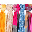 Stock Photo: Many bright female scarfs isolated on white