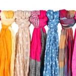 Many bright female scarfs isolated on white — Stock Photo #21388959