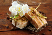 Natural handmade soap, on wooden background — Stock Photo