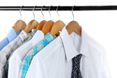 Shirts with ties on wooden hangers isolated on white — Stock Photo