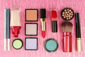 Decorative cosmetics on pink background — Stock Photo