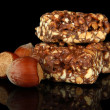 Chocolate sweets with nuts, isolated on black — Stock Photo