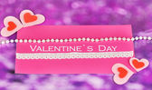 Greeting card for Valentine's Day on purple background — Stock Photo