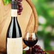 Composition of wine, wooden barrel and grape, on bright background — Stock Photo #21503683