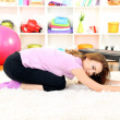 Young woman doing fitness exercises at home - Foto de Stock