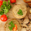 Fresh pate on wooden spoon, on wooden background — Стоковая фотография